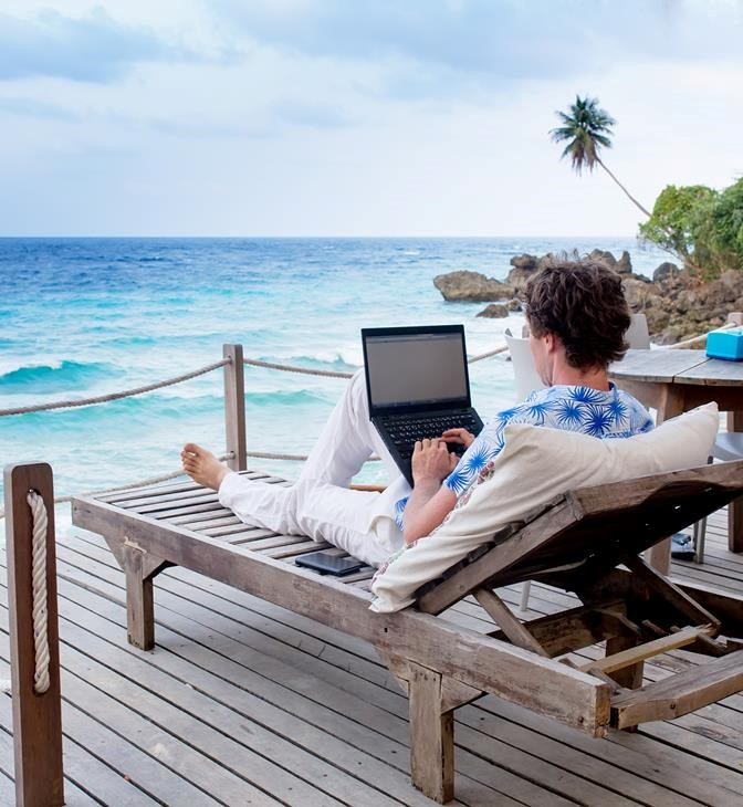 man-on-beach-with-laptop